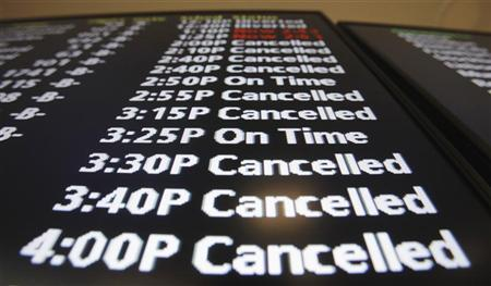 A flight information board shows the status of outgoing flights at Newark Liberty International Airport in New Jersey December 27, 2010. REUTERS/Lucas Jackson