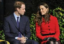 <p>Britain's Prince William and his fiancee Kate Middleton listen to speeches during their visit St. Andrews University in Fife, Scotland February 25, 2011. REUTERS/Toby Melville</p>