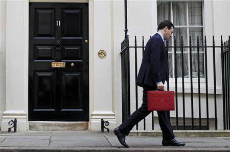 Britain's Chancellor of the Exchequer George Osborne walks away after holding his budget case for the cameras outside number 11 Downing Street, before delivering his budget to the House of Commons in London March 23, 2011. REUTERS/Stefan Wermuth