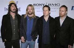 <p>Members of the band Foo Fighters (L-R) Dave Grohl, Taylor Hawkins, Chris Shiflett and Nate Mendel attend the Clive Davis Pre-Grammy Party in Beverly Hills, California February 9, 2008. REUTERS/Phil McCarten</p>