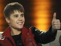 """<p>Canadian singer Justin Bieber gives a thumbs-up during the German TV game show """"Wetten Dass...?"""" (Let's make a bet) in Augsburg, southern Germany March 19, 2011. REUTERS/Christof Stache/Pool</p>"""