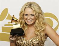 """<p>Country music singer Miranda Lambert poses with her Best Female Country Vocal Performance award for """"The House That Built Me"""" backstage at the 53rd annual Grammy Awards in Los Angeles, California February 13, 2011. REUTERS/Mario Anzuoni</p>"""