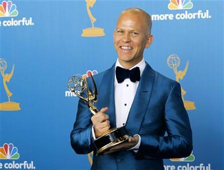 Ryan Murphy poses with his award for outstanding writing for a comedy series for ''Glee'' at the 62nd annual Primetime Emmy Awards in Los Angeles, California August 29, 2010. REUTERS/Danny Moloshok