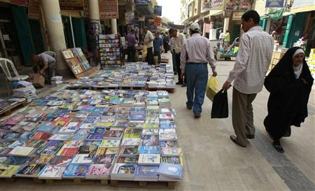 Residents shop for books at Mutanabi Street in Baghdad April 5, 2011. REUTERS/Mohammed Ameen