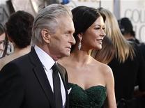 <p>Catherine Zeta-Jones and Michael Douglas arrive at the 68th annual Golden Globe Awards, January 16, 2011. REUTERS/Danny Moloshok</p>