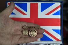 <p>Romanian jeweller Ovidiu Paraianu shows two special rings and an ornamental key he created, which he hopes to give to Britain's Prince William and Kate Middleton for their wedding, during an interview in Bucharest April 15, 2011. REUTERS/Radu Sigheti</p>