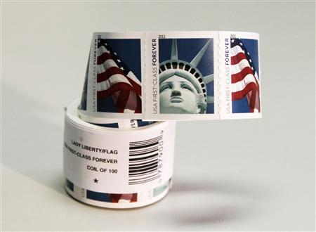 A Coil Of 100 New USA First Class Postage Stamps Bearing An Image The Statue Liberty And US Flags Is Shown In Washington April 15 2011