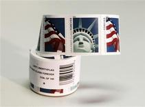 "<p>A coil of 100 new USA First Class postage stamps, bearing an image of the Statue of Liberty and U.S. flags, is shown in Washington, April 15, 2011. The new U.S. first-class postage stamp, which shows a low-angled close-up of Lady Liberty's face and crown, was issued in December, according to an announcement about the ""world-recognized"" symbol of the United States. The statement described the statue as a gift from the people of France, designed by sculptor Frederic-Auguste Bartholdi, which stands 305 feet tall on Liberty Island off the tip of Manhattan, ""a symbol of political freedom and democracy for millions of people around the world."" None of this is quite true of the image shown on the stamp, which is actually a photo of a half-sized replica of the statue that was created for and stands outside the New York-New York Hotel & Casino in Las Vegas. REUTERS/Hyungwon Kang</p>"