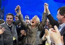 <p>Pauline Marois (C), leader of Parti Quebecois, celebrates the result of her leadership review vote at the party's national convention in Montreal, April 16, 2011. REUTERS/Christinne Muschi</p>