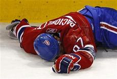 <p>Montreal Canadiens Max Pacioretty lies on the ice after being hit into a glass stanchion by Boston Bruins Zdeno Chara during the second period of NHL hockey play in Montreal, March 8, 2011. REUTERS/Shaun Best</p>