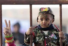 <p>A boy attends a protest against Libya's Muammar Gaddafi in Benghazi March 8, 2011. REUTERS/Suhaib Salem</p>