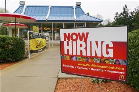 A ''Now Hiring'' sign is seen in front of a McDonald's restaurant in FairOaks, Virginia April 19, 2011. REUTERS/Larry Downing
