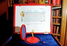 <p>The Instrument of Consent, which is the Queen's formal consent to Prince William's forthcoming marriage to Kate Middleton, is seen at the Crown Office at the House of Lords in London April 20, 2011. Britain's Queen Elizabeth has given her formal consent to the marriage of grandson Prince William and Kate Middleton in the form of a historic hand written legal document made of vellum and elaborately illuminated. Photograph taken April 20, 2011. REUTERS/Clive Gee/pool</p>