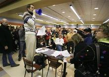 <p>Democratic Caucus precinct chairman Greg Nichols calls the caucus to order with a Hillary Clinton campaign-provided megaphone, as caucus-goers participate in the Iowa caucus 212th precinct at Valley High School in West Des Moines, Iowa January 3, 2008. REUTERS/Jim Bourg</p>