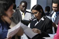 <p>People wait in line to enter the City University of New York (CUNY) Big Apple job fair in New York April 23, 2010. REUTERS/Shannon Stapleton</p>