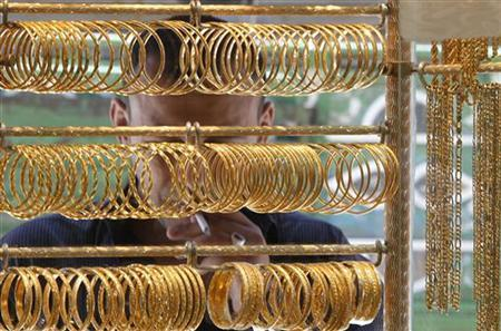 A Man Looks At Gold Jewellery Displayed In Amman S Market April 25
