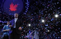 <p>Conservative Party leader and Canadian Prime Minister Stephen Harper greets supporters with his son Ben following his victory speech at his federal election night headquarters in Calgary, Alberta, May 2, 2011. REUTERS/Todd Korol</p>