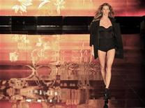 <p>Brazilian model Gisele Bundchen presents a creation from Colcci's Winter 2011 collection during Sao Paulo Fashion Week January 30, 2011. REUTERS/Nacho Doce</p>