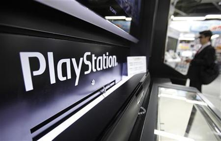 A man plays a game on Sony Corp's PlayStation 3 game console at an electronic store in Tokyo April 27, 2011. REUTERS/Yuriko Nakao