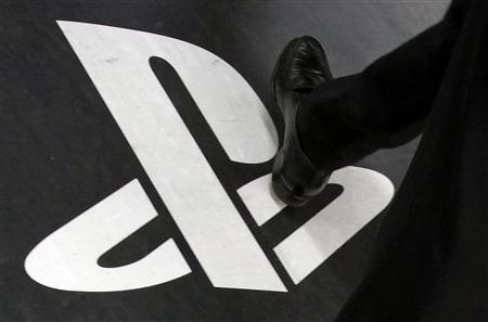 A man walks on a floor advertisement for Sony Corp's PlayStation 3 game console at an electronic store in Tokyo in this April 27, 2011 file photo. REUTERS/Yuriko Nakao/Files