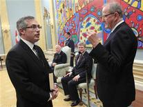 <p>Tony Clement (L) is sworn-in as the President of the Treasury Board and Minister for the Federal Economic Development Initiative for Northern Ontario during a ceremony at Rideau Hall in Ottawa May 18, 2011. REUTERS/Chris Wattie</p>