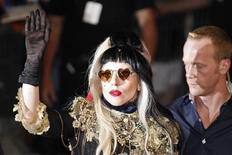 """<p>Singer Lady Gaga waves to fans after she performed on the Canal Plus television show """"Le Grand Journal"""" in Cannes during the 64th Cannes Film Festival, May 11, 2011. REUTERS/Yves Herman</p>"""