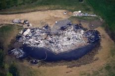 <p>An aerial view of ashes and debris of a house burned down by a wild fire in Slave Lake, is pictured in Alberta, May 20, 2011. Parts of the town were devastated by wild fires that rolled through the area May 15 and 16th. About 80 wildfires are burning in Alberta, spurred by warm temperatures and gusting winds, with 23 considered out of control in a fire season unlike any seen before. REUTERS/Todd Korol</p>