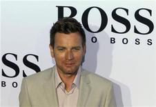 <p>Scottish actor Ewan McGregor poses for pictures before a Boss Black line fashion show by German fashion house Boss at Berlin Fashion Week Spring/Summer 2011 in Berlin, July 8, 2010. REUTERS/Thomas Peter</p>