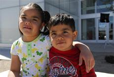 <p>Cecilia and Emmanuel (R), children available for adoption, are seen in this undated handout image obtained by Reuters June 4, 2011. REUTERS/Sebastein Darteville-Courtesy Heart Gallery/Handout</p>