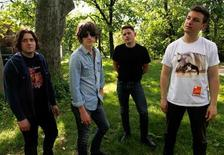 <p>Members of the Arctic Monkeys (L-R) Jamie Cook, Alex Turner, Nick O'Malley and Matt Helders pose for a portrait in New York's Central Park May 24, 2011. REUTERS/Jessica Rinaldi</p>
