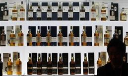<p>Bottles of malt whiskey are displayed at a whiskey merchandising event in Tokyo February 10, 2008. REUTERS/Issei Kato</p>