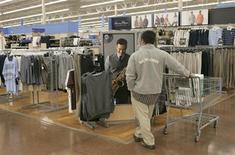 <p>A customer views clothing items while late night shopping at a Walmart Supercenter in American Canyon, California September 30, 2009. REUTERS/Robert Galbraith</p>