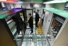 <p>Men use computers in server cabinets at the stand of the industrial enclosures manufacturer Rittal at the CeBIT exhibition centre in Hanover March 1, 2010. REUTERS/Thomas Peter</p>