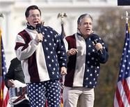 """<p>Comedians Jon Stewart (R) and Stephen Colbert sing during the """"Rally to Restore Sanity and/or Fear"""" on the Washington Mall, October 30, 2010. REUTERS/Jason Reed</p>"""
