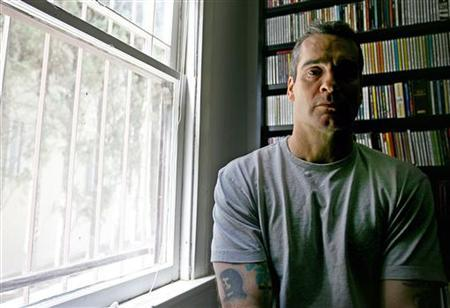 Henry Rollins, former lead singer of the seminal punk rock band ''Black Flag'' is seen at his office in Hollywood, California March 9, 2006. REUTERS/STR New