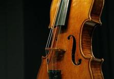 "<p>A Stradivarius violin known as ""The Penny"" is displayed at Christie's auction house in New York March 27, 2008. REUTERS/Brendan McDermid</p>"