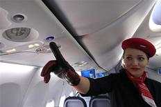 <p>An airberlin stewardess shows the new call button in the Boeing 737 during 49th Paris Air Show at the Le Bourget Airport, near Paris June 21, 2011. REUTERS/Pascal Rossignol</p>