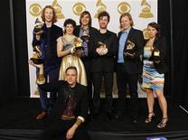 """<p>Members of the Canadian band Arcade Fire including lead singer Win Butler, seated front, pose with their Album of the Year awards for the album """"The Suburbs"""" at the 53rd annual Grammy Awards in Los Angeles, California February 13, 2011. REUTERS/Mario Anzuoni</p>"""