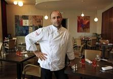 <p>French chef Olivier Douet, who won a one star in the 2006 Michelin Guide, poses in his restaurant in Nimes, June 22, 2011. REUTERS/Jean-Paul Pelissier</p>