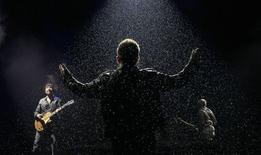 <p>Bono, lead singer of Irish band U2, performs with The Edge (L) and Larry Mullins(R) on the third day of the Glastonbury Festival in Worthy Farm, Somerset June 24, 2011. REUTERS/Cathal McNaughton</p>
