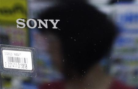 A woman is reflected on a Sony product at an electronics store in Tokyo June 28, 2011. Sony Corp believes it was targeted by hackers because it tried to protect its intellectual property, CEO Howard Stringer told a shareholders' meeting at which he sidestepped a call for him to step down over the incident. REUTERS/Toru Hanai