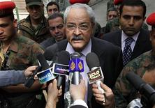 <p>Egypt's Finance Minister Samir Radwan speaks to the media as the Egyptian stock exchange celebrates its reopening, in Cairo March 23, 2011. REUTERS/Mohamed Abd El-Ghany</p>