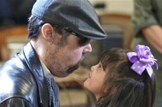 <p>Full face transplant patient Dallas Wiens (L) is seen with his four-year old daughter Scarlette in this undated handout image. REUTERS/Courtesy of Lightchaser Photography/Handout</p>