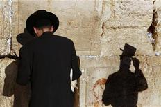 "<p>An ultra-Orthodox Jewish man stands in front of the Western Wall, Judaism's holiest prayer site, in Jerusalem's Old City September 14, 2009, as he takes part in a ""global day of prayer"" called by Orthodox rabbis in response to what they described as mounting threats to Israel.REUTERS/Yannis Behrakis</p>"