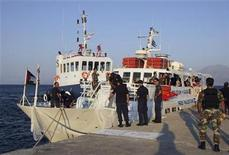"<p>Greek coastguards stand in front of Canadian boat ""Tahrir"" after forcing the Gaza-bound ship to return to the port of Agios Nikolaos on the island of Crete July 4, 2011. REUTERS/Stefanos Rapanis</p>"