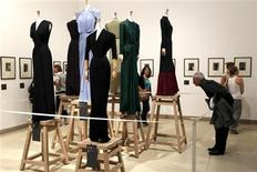 """<p>A visitor looks at the creation """"Evening sheath dress, around 1947"""" by French fashion designer Madame Gres (1903-1993) which are displayed during the exhibition """"Madame Gres, Couture at Work"""" at the Bourdelle Museum in Paris July 7, 2011. REUTERS/Charles Platiau</p>"""