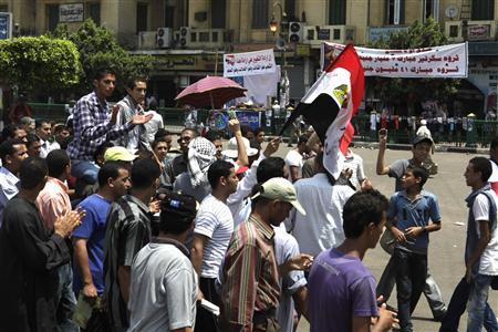 Protesters chant slogans against the government and military rulers in Tahrir square in Cairo July 11, 2011. Egyptian activists vowed on Sunday to stay camped in Cairo's Tahrir Square, accusing the army rulers of failing to sweep out corruption, end the use of military courts and swiftly try those who killed protesters. REUTERS/Asmaa Waguih