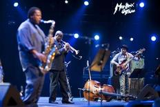 <p>Jazz bassist Marcus Miller (R) performs onstage with saxophonist Wayne Shorter (L) and trumpeter Sean Jones during the tribute to Miles Davis evening at the 45th Montreux Jazz Festival in Montreux July 13, 2011. REUTERS/Valentin Flauraud</p>