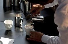 <p>Sener Soenmez from Hamburg makes a cappuccino during the finals of the German Barista Championships in Hamburg April 17, 2011. REUTERS/Morris Mac Matzen</p>