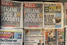 <p>The last edition of News of the World newspaper goes on sale alongside other British Sunday newspapers in London in this July 9, 2011 file photo. REUTERS/Paul Hackett/Files</p>